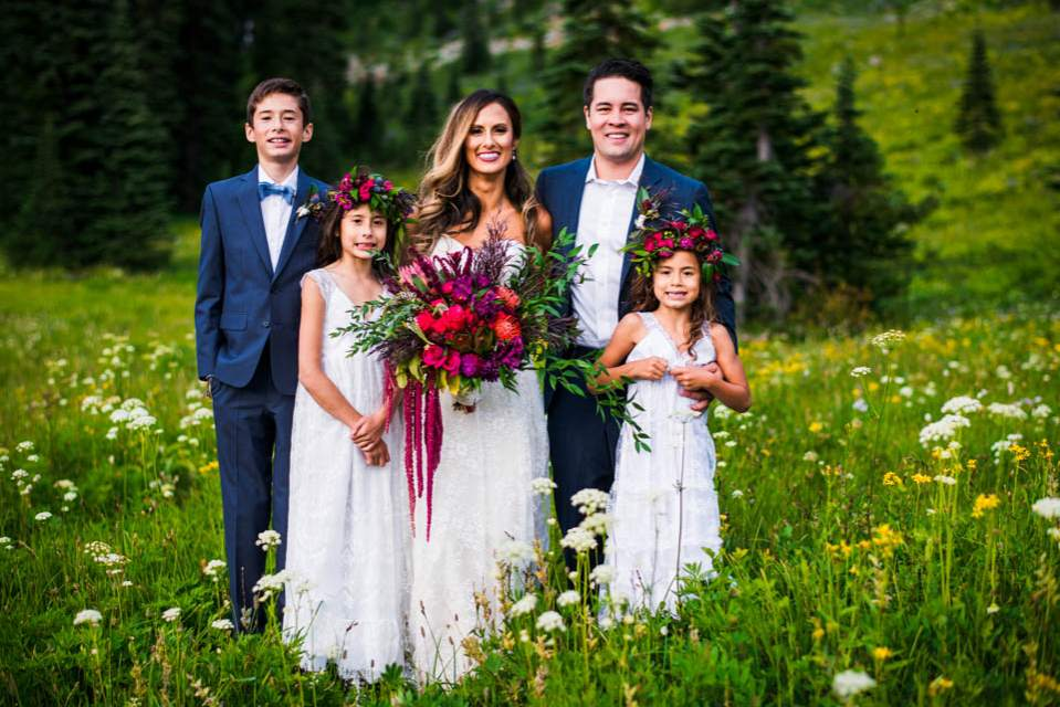 bride and groom with their kids