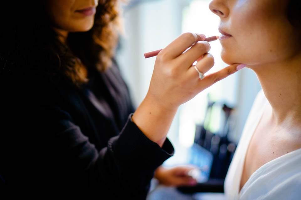 bride having make up applied for wedding