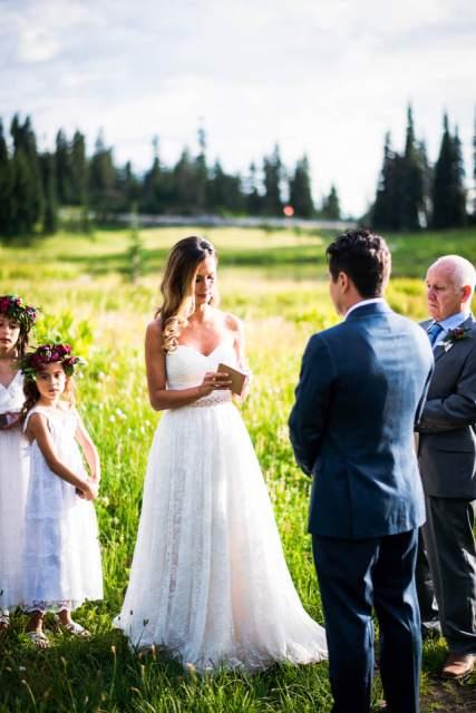bride reading vows at adventure elopement