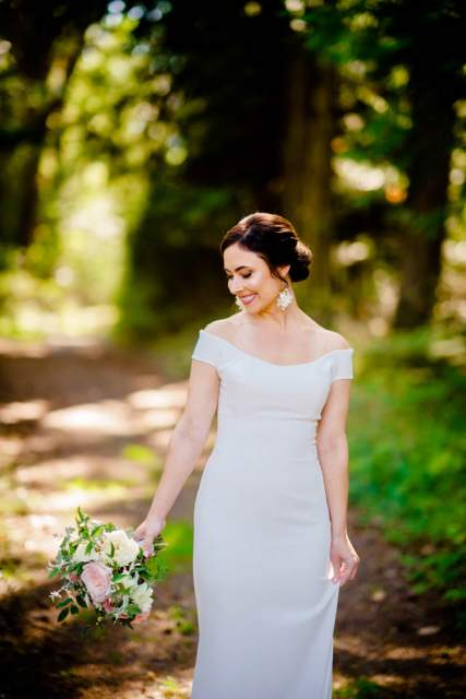 bride standing in forest on san juan island