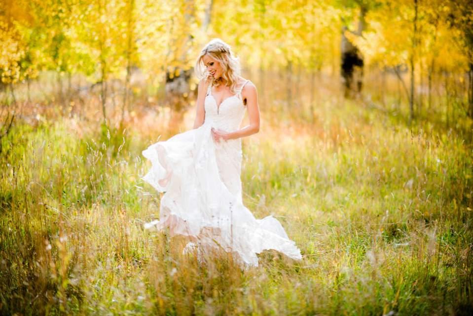 bride twirling in aspen trees