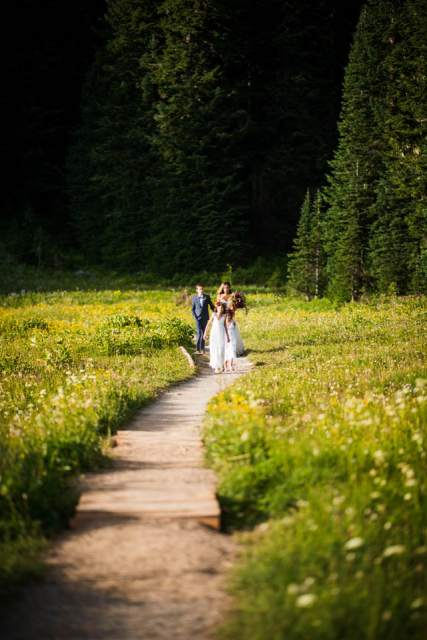 bride walking down trail to ceremony