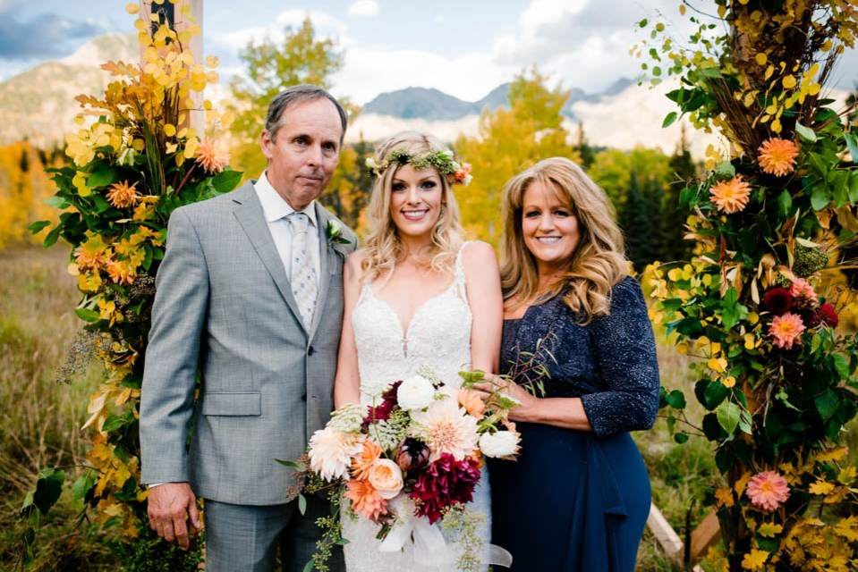 bride with parents on wedding day
