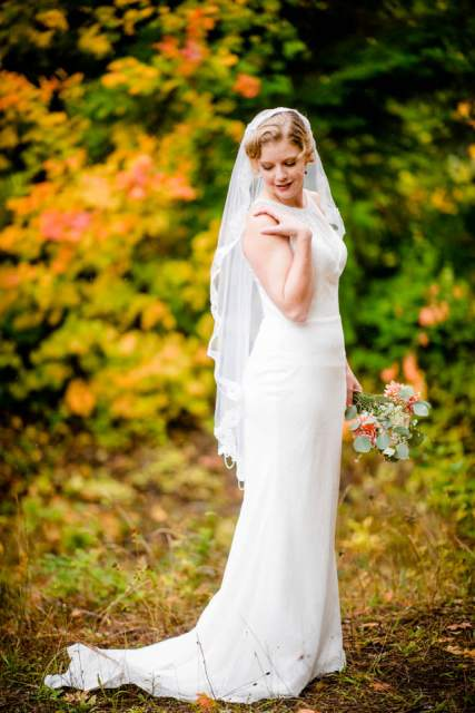 bride with veil in fall leaves 2