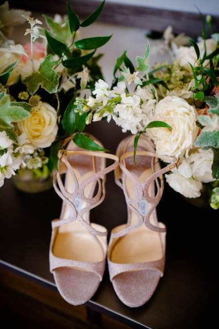 brides shoes and wedding flowers