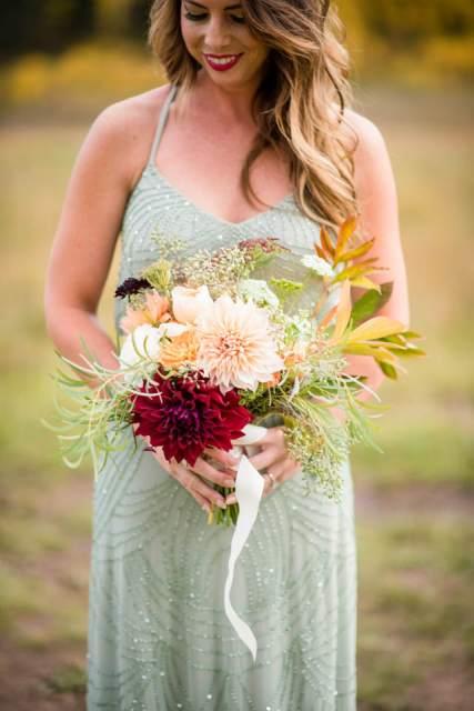 bridesmaid with dahlia bouquet