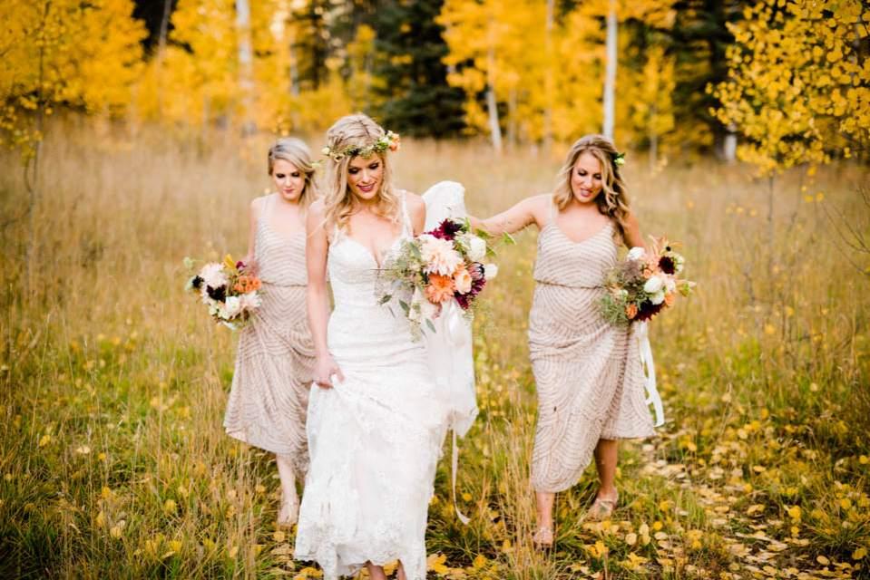 bridesmaids helping bride to ceremony