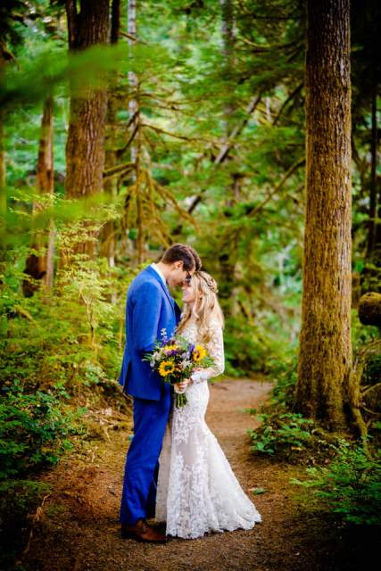 couple embracing in the woods at olympic national park