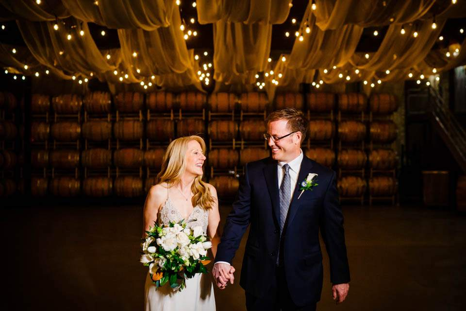 creative lighting in winery barrel room for wedding photos