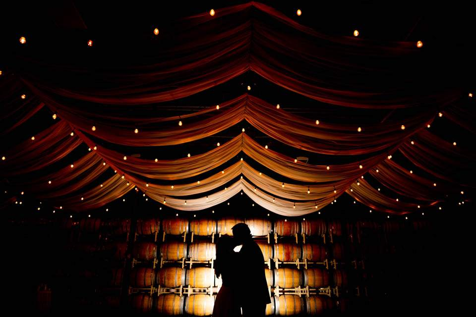 creative lighting photo in barrel room at columbia winery wedding in woodinville