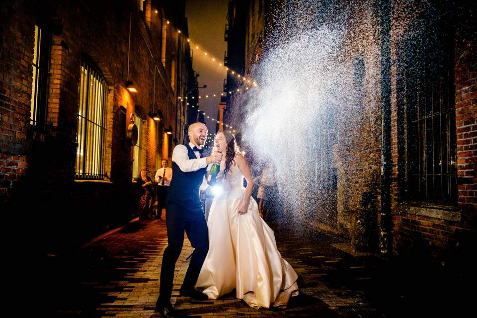 downtown seattle alley bride and groom champagne shot