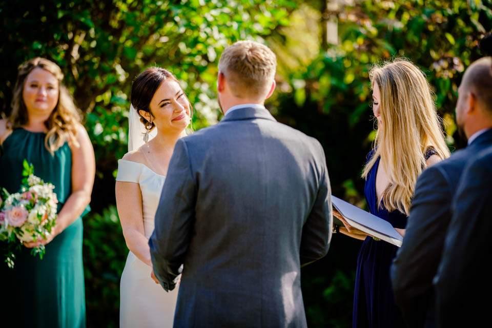 emotional bride looks at groom during wedding ceremony