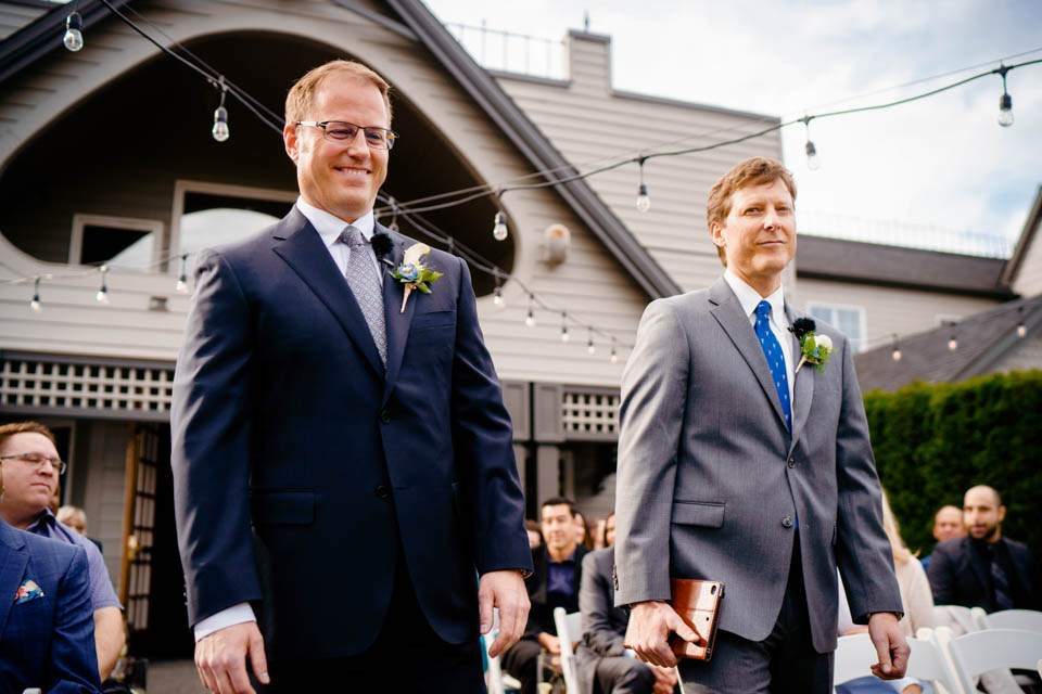 groom and officiant walking down aisle together