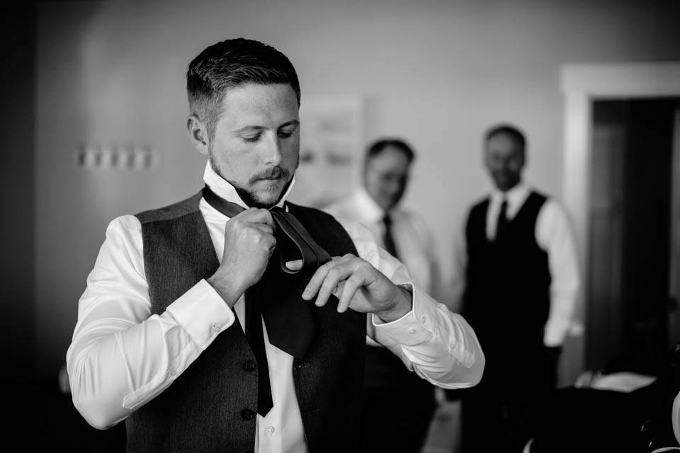 groom getting ready in guest house