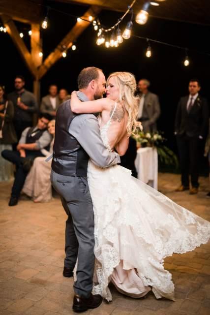 groom spinning bride on dance floor