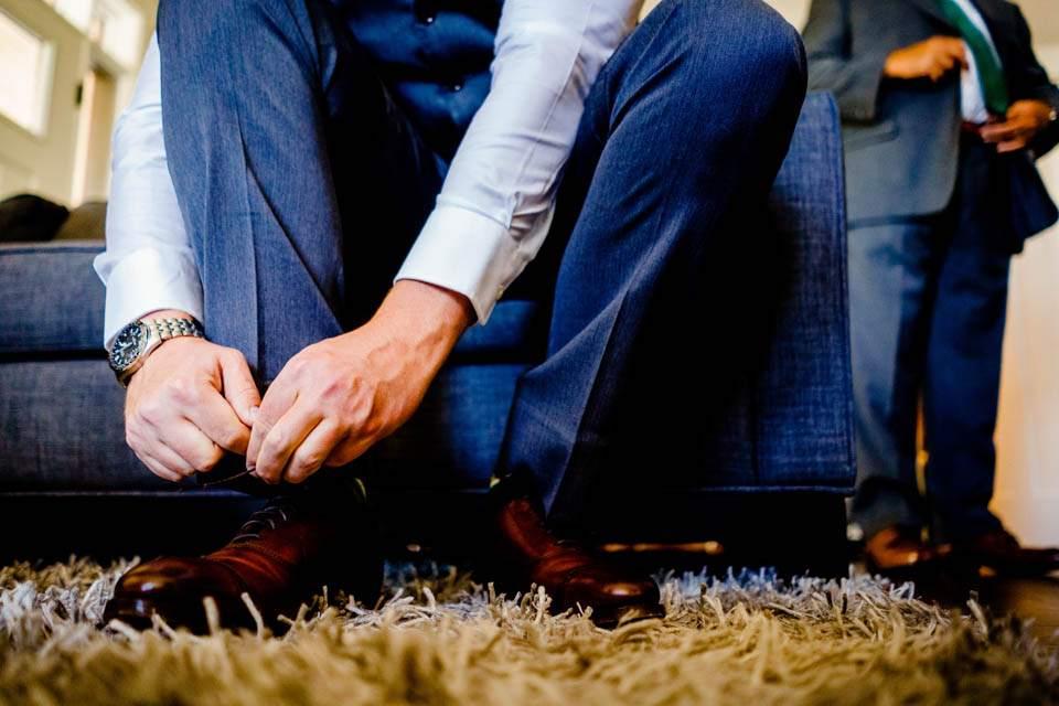 groom tying shoe