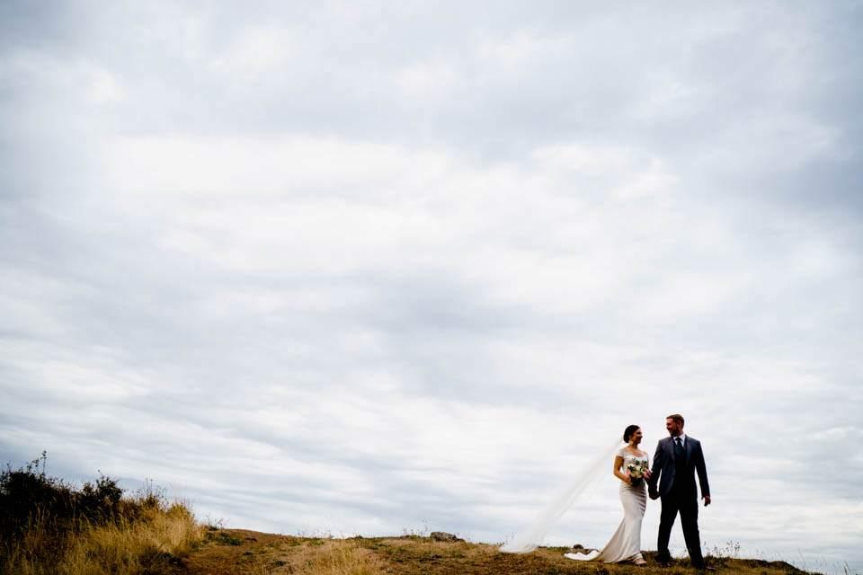 silhouette of bride and groom walking