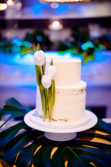 simple wedding cake decorated with tulips
