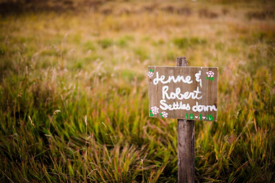 trail sign pointing to adventure wedding spot