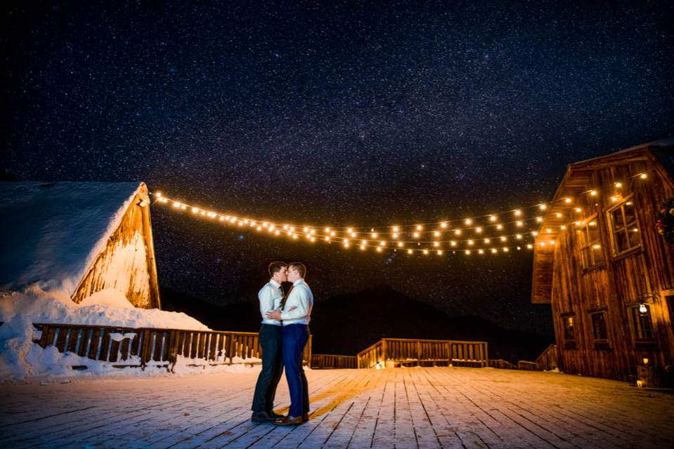 two grooms kiss under the stars creative mountain wedding photographers