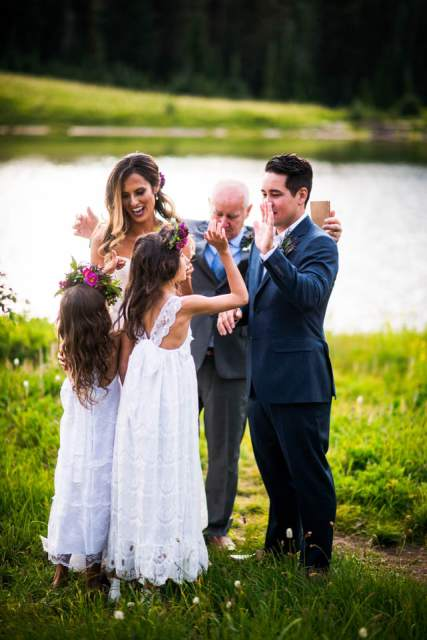 wedding couple give kids high five