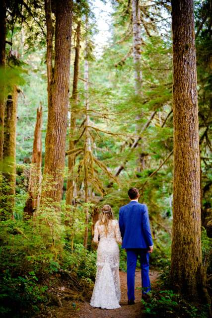 wedding couple walking through rainforest