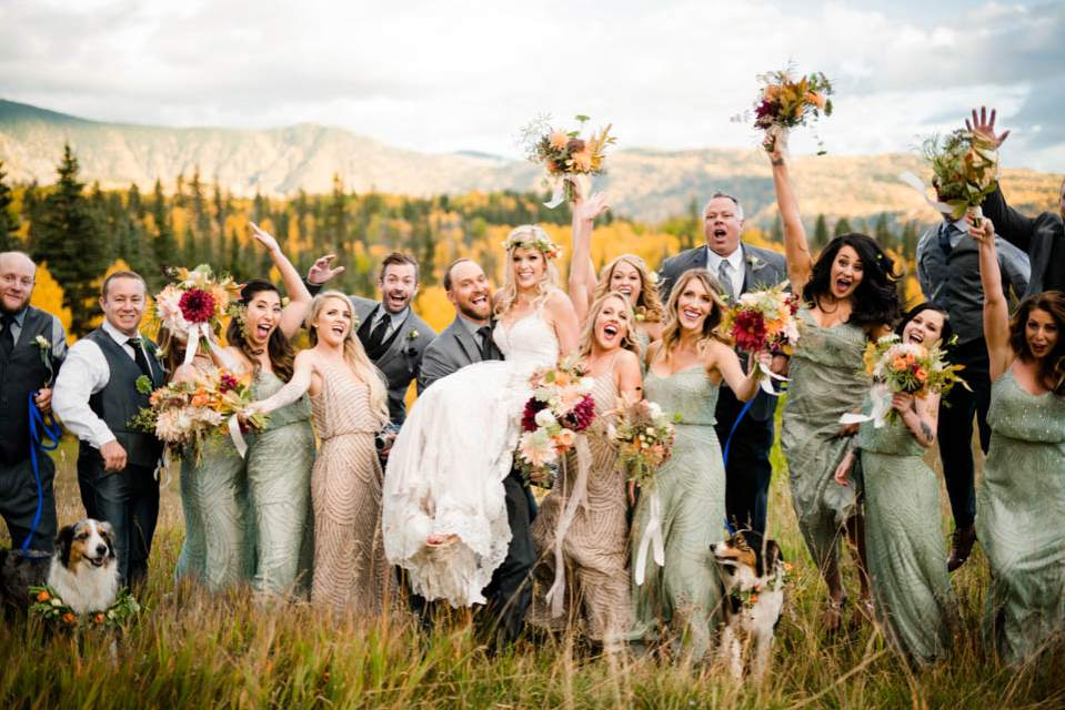 whole wedding party cheering and celebrating